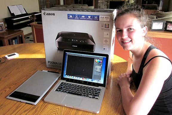 Elizabeth Koskiewicz proudly displays her new Magnificent Machine.